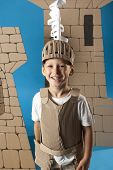stock photo of berserk  - photo of the boy in medieval knight costume made of cardboards - JPG
