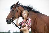 Beautiful woman cuddling a horse