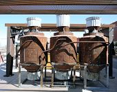stock photo of miniature golf  - Some old rusty boiler at a miniature golf park - JPG