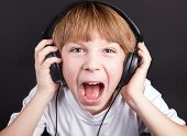 Young boy's singing with headphones