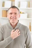Man doing EFT on the under collarbone. Emotional Freedom Techniques, tapping, a form of counseling intervention that draws on various theories of alternative medicine.