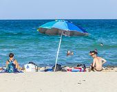 People Enjoy The Afternoon Sun At South Beach In Miami