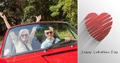 Mature couple in red cabriolet cheering at camera against cute valentines message