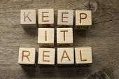 keep it real text on a wooden background