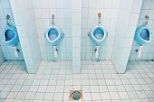 stock photo of urination  - Detail with four blue urinals in a public men - JPG