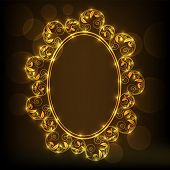 Beautiful floral design decorated golden frame in brown background.