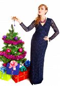 Portrait Of A Beautiful Young Woman With A Glass Of Champagne Near The Christmas Tree