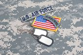 picture of army  - US ARMY airborne tab with blank dog tags on camouflage uniform - JPG