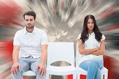 Angry couple not talking after argument against love heart pattern