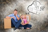 Unhappy young couple sitting beside moving boxes against life thoughts