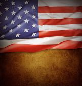Closeup of American flag on brown background