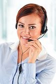 stock photo of helpdesk  - Call center operator in the office - JPG