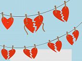 Broken Hearts hanging from clothing line from pegs