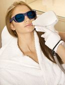 Portrait of young adult attractive and sensuality brunette pretty girl receiving laser therapy procedure. Woman getting laser face treatment in medical spa center skin rejuvenation concept