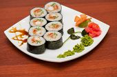 sushi rolls with crabs meat at plate
