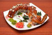 stock photo of dragon-fish  - Roll dragon made of smoked eel at plate - JPG