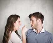 Casual young couple in an argument against weathered surface