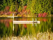 image of dock a lake  - Image taken towards the end of the day of an abandoned swimming dock on Lost Lake in Whistler - JPG