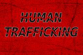 Stop human trafficking - conceptual illustration with shattered text in grunge style on blood red background