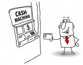 cash machine. Joe withdraws money at the cash machine