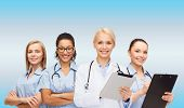 healthcare and medicine concept - smiling female doctor and nurses with tablet pc