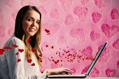 Businesswoman typing on her laptop against hearts
