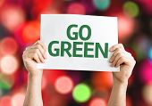 Go Green card with colorful background with defocused lights