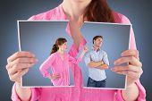 Woman arguing with uncaring man against grey vignette
