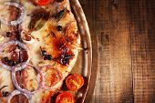 foto of pangasius  - Dish of Pangasius fillet with spices and vegetables in metal tray on wooden table background - JPG