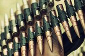 picture of guns  - Bullets in ammunition belt for machine gun - JPG