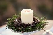 candlestick with burning candle in the nature