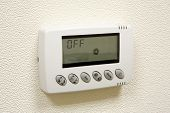 Digital Climate Thermostat On The Wall