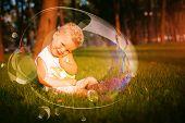 Little Shy Boy Sitting On Grass