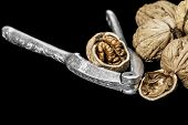 foto of nutcracker  - Nutcrackers and walnuts on a black background - JPG