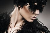Mysterious Woman With Black Feathers On Eyes