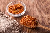 Spices Saffron In A Glass Bowl And Spoon