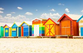 stock photo of bathing  - Beautiful Bathing houses on white sandy beach at Brighton in Melbourne - JPG