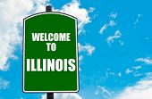 stock photo of illinois  - Green road sign with greeting message Welcome to ILLINOIS isolated over clear blue sky background with available copy space - JPG