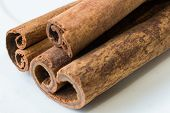 image of cinnamon sticks  - Cinnamon sticks on white background close up - JPG