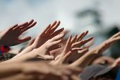 foto of hand god  - Hands of the people at the rally - JPG