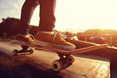 stock photo of skateboard  - skateboarding legs riding on skateboard at skatepark - JPG