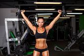 pic of barbell  - beautiful sports fitness girl with a barbell in the gym - JPG