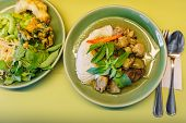 pic of curry chicken  - chicken green curry sauce with rice noodles Thai food - JPG