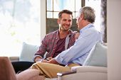 picture of sofa  - Senior Father With Adult Son Relaxing On Sofa At Home - JPG