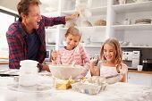 picture of three sisters  - Father baking with children - JPG