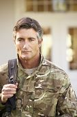 image of soldier  - Soldier Returning To Unit After Home Leave - JPG