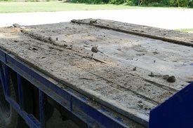 foto of dumper  - dirt on the old blue truck dumper for construction - JPG