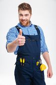 Happy male builder showing thumb up isolated on a white background poster