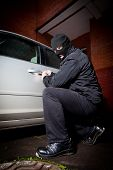 foto of scumbag  - robber and the thief hijacks the car - JPG