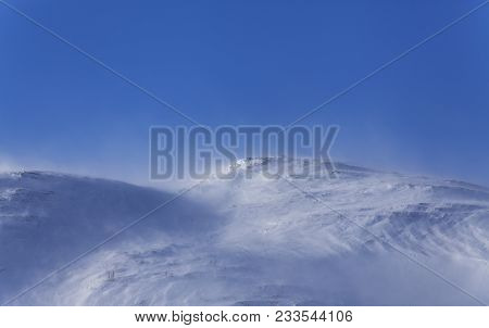 Mountainside In Strong Wind Snowstorm